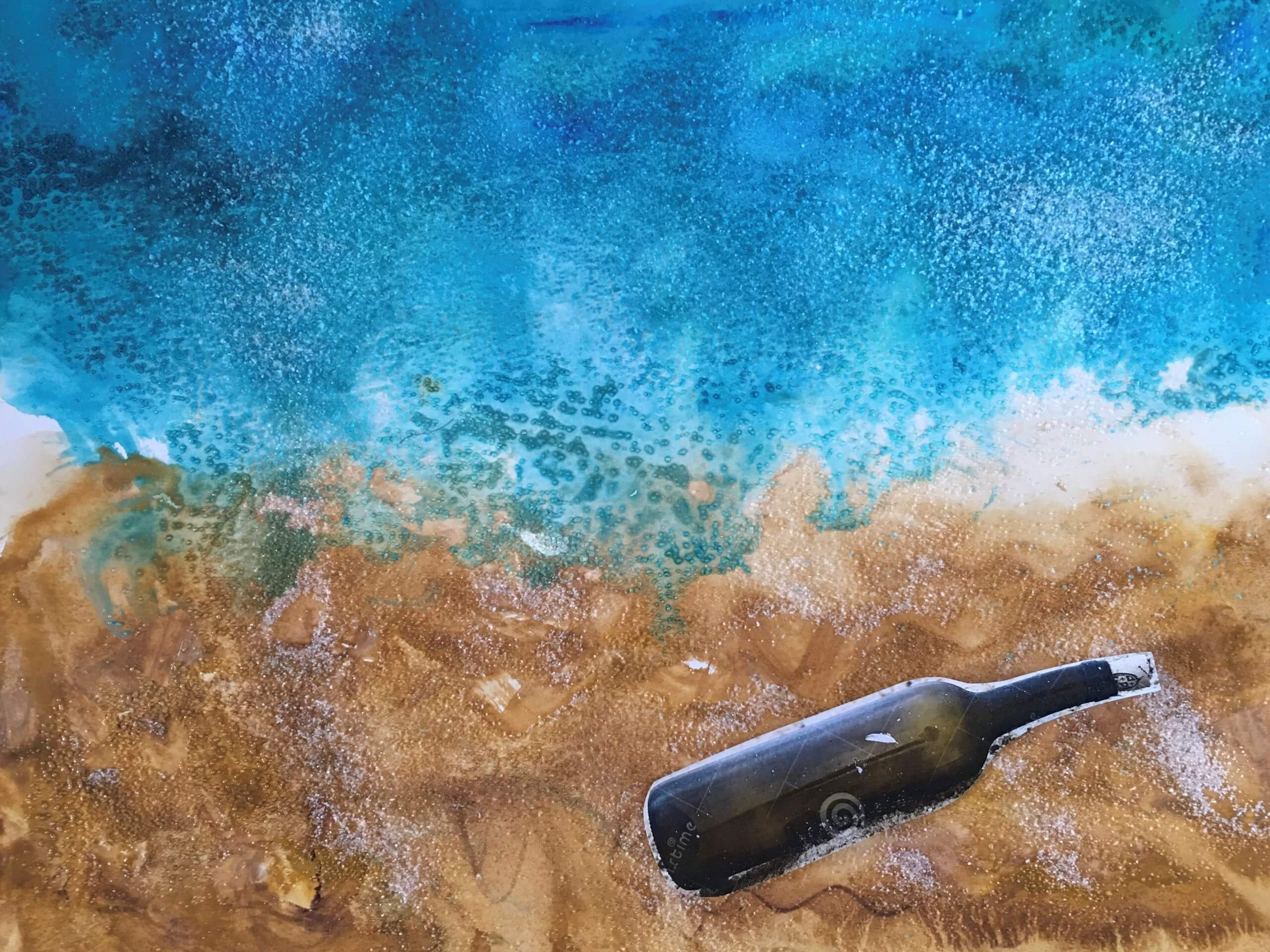 A mixed media artwork that has a textured background that resembles water meeting a shore. A long bottle is cutout and collaged in the lower right as if it has washed to shore.