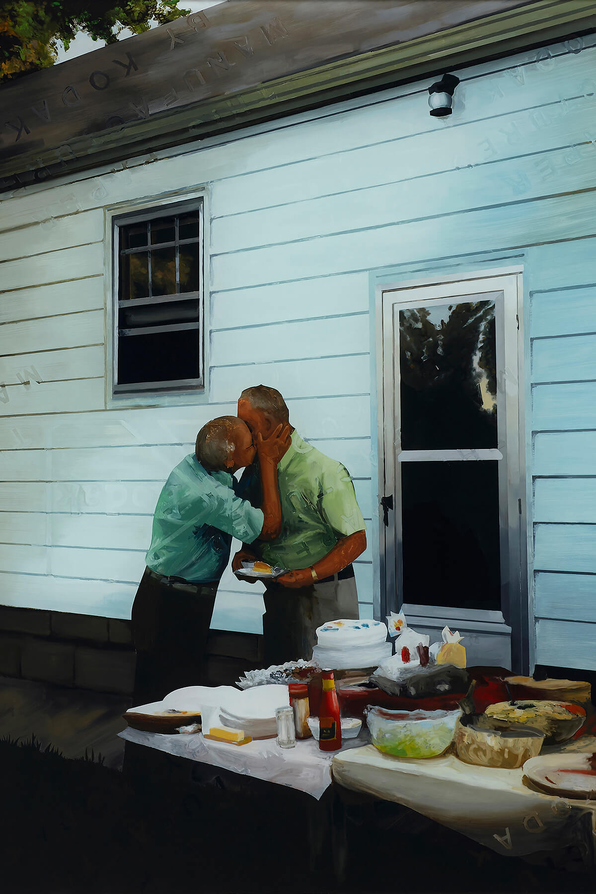 A vertically oriented photograph of two older white men kissing on the mouth. They are on the side of a house with white siding and a picnic table full of food.